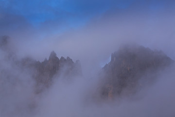 Dramatic clouds at sunset and beautiful light in the Dolomite Alps