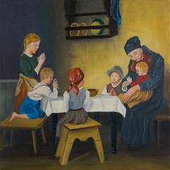 Eine Frau und fünf Kinder am Tisch beim Gebet