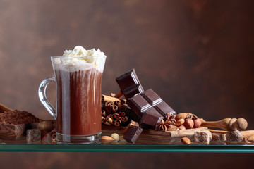 Cocoa with cream,  chocolate pieces and various spices.