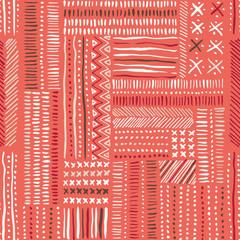 Hand drawn tribal marks, cross stitches on coral background vector seamless pattern. Abstract geometric print