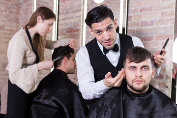 Hairdresser discussing preferences with male client
