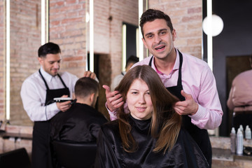 Female discussing haircut with hairdresser