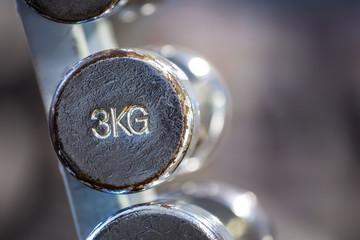 Old chrome 3kg dumbbell in a rack.