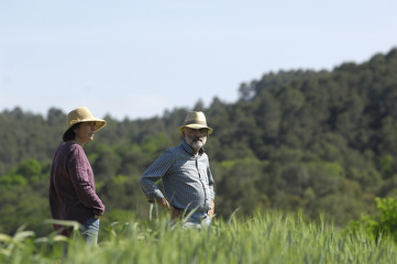portrait of a couple farmers on the field