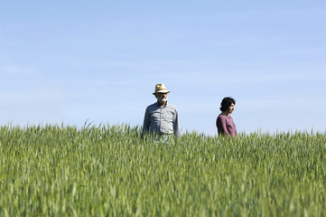 couple farmers on a wheat fileld
