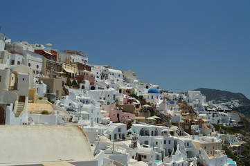 Infinite Hillside Full Of Typical White And Blue Houses In The Beautiful City Of Oia On The Island Of Santorini. Architecture, landscapes, travel, cruises. July 7, 2018. Santorini, Thera. Greece.