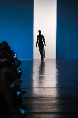 A model on the catwalk finishing the parade during the fashion week presentation.