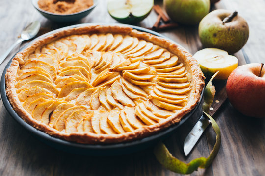 Traditional apple tart on rustic wooden background
