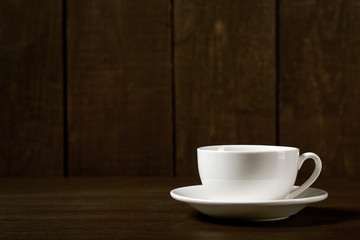 one classic coffee or tea cup on a dark wooden background
