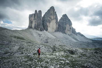 Man hiker with backpack on the Tre Cime di Lavaredo tour. beautiful surroundings at summer time, Dolomites in Italy, Europe