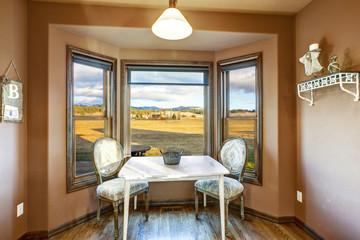 Breakfast nook with brown walls