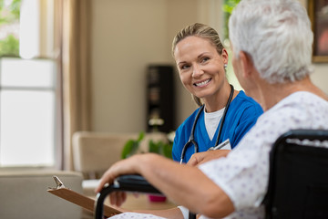 Friendly nurse talking to senior patient