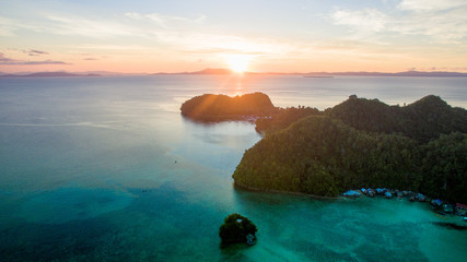 living in the jungle island little planet pacific ocean sunset siargao aerial view drone