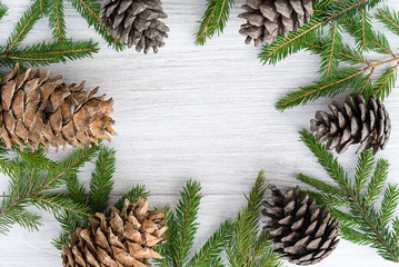 Christmas background - circle frame made of fir branches and cones.
