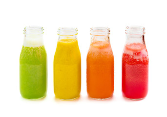 Colourful smoothie juice bottles isolated on white background