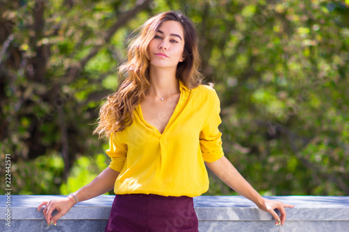Portrait of a smiling girl in bright yellow clothes. Natural beauty concept. e3e091ec4