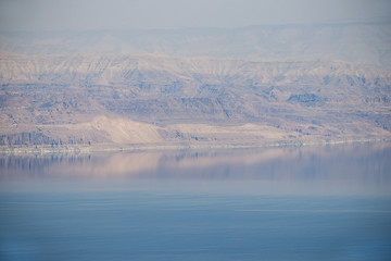 View of the Jordanian mountains and the Dead Sea at sunset time