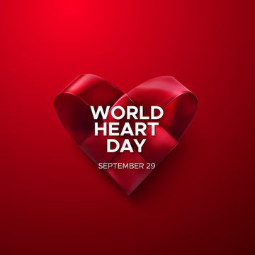 Realistic satin ribbon woven heart with World Heart Day text label. Vector health care illustration. Medical awareness day concept
