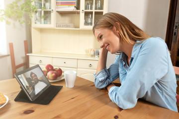 Woman talking through a video chat
