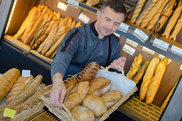 bakery shopkeeper is proud of his bread production Fototapete