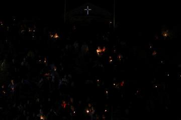 Orthodox Christian pilgrims pray on the eve of the Elevation of the Cross holiday at Krustova Gora
