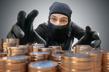 Robber or thief is trying to grab and steal coins.