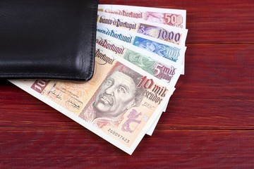 Portuguese money in the black wallet
