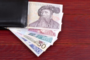 Old money from Sweden in the black wallet