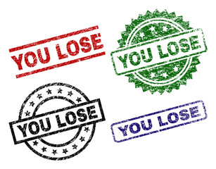 YOU LOSE seal stamps with corroded style. Black, green,red,blue vector rubber prints of YOU LOSE title with corroded surface. Rubber seals with round, rectangle, medal shapes.