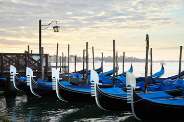 Gondolas in Grand Canal in the early morning in Venice, Italy