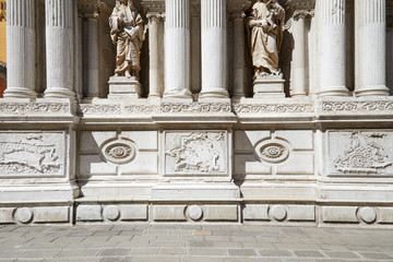 Baroque, white architecture with statues and columns background in a sunny day in Italy