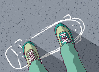 skateboard painted on pavement and man feet top view