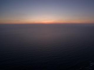 sunset cap ferret france horizon blue atlantic ocean aerial drone shot