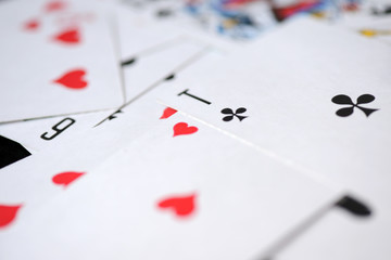 Background of playing cards scattered on a table close up