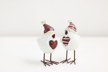 Decoration of Merry Christmas: two cute birds tweet & have a good laugh together. This image is isolated on white background. Concept: Happy Holidays.