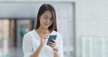 Woman use of smart phone in campus