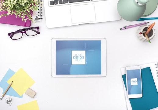 Tablet and Smartphone on White Desk Mockup