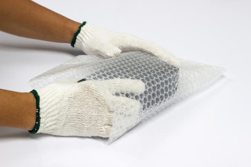 hand man hold bubble wrap, for Packing and protection product cracked or insurance During transit.