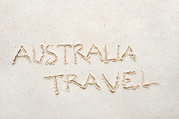 "Handwriting words ""Australia travel"" on sand"