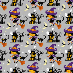 Halloween themed seamless vector pattern with cute witches, black cats, ghosts and haunted houses on grey background.