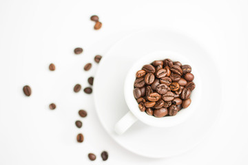 coffee cup full of roasted coffee beans