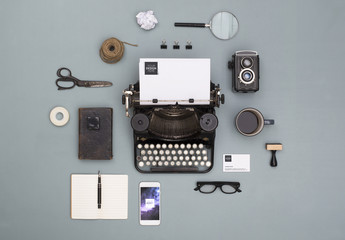 Letterhead and Smartphone on Gray Background with Vintage Items Mockup