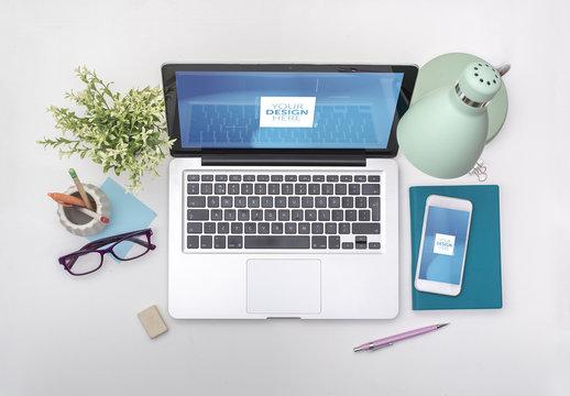 Laptop and Smartphone on White Desk Mockup