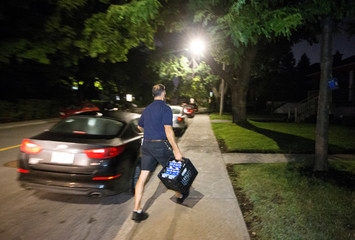 Milkman Patrick Moisan begins his delivery rounds in a neighbourhood in Montreal, Quebec, Canada