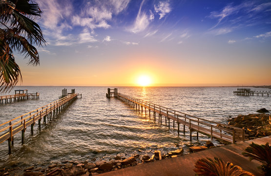 Long wooden fishing docks stretch out into Galveston Bay, Texas