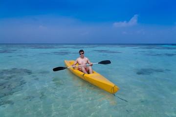 Maldives,  man in canoe