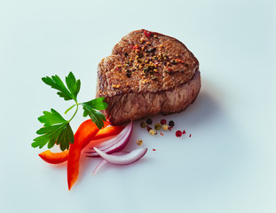 Fillet of beef steak with onions on white background