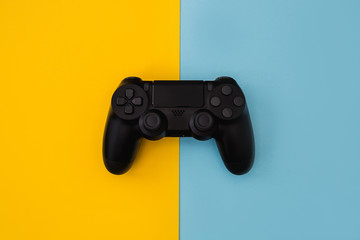 Video games gaming controller isolated on yellow blue background Fotoväggar