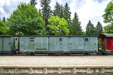 Train wagon with cargo on a railway at a station