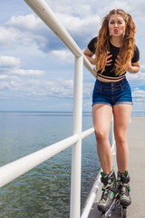 Joyful teen girl wearing roller skates